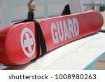 Lifeguard rescue tube on pool...