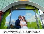bride and groom kissing in... | Shutterstock . vector #1008989326