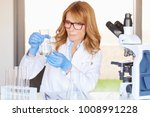 middle aged female doctor... | Shutterstock . vector #1008991228