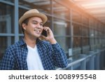 young man talking on phone | Shutterstock . vector #1008995548