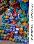 Small photo of A display of traditioal decorated pottery In the Souk the Street Market at Jemaa el Fnaa in the Medina Old City in the centre of Marrakech in Morocco. The Souk is enjoyed by visitors and tourists.