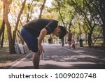a tired man exhausted after an... | Shutterstock . vector #1009020748