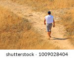 A Man In Shorts  A White T...