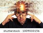 man crazy inventor wearing a... | Shutterstock . vector #1009033156