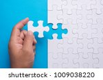 hand holding piece of white... | Shutterstock . vector #1009038220