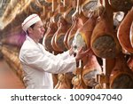 in a ham factory  a man in... | Shutterstock . vector #1009047040