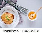 banana pancakes with walnuts... | Shutterstock . vector #1009056310