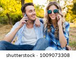 young stylish couple sitting in ...   Shutterstock . vector #1009073308