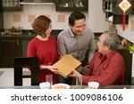 asian couple giving present for ... | Shutterstock . vector #1009086106