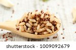 cooked quinoa brown rice in a... | Shutterstock . vector #1009092679