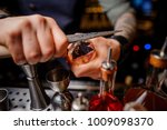 bartender in a blue shirt with... | Shutterstock . vector #1009098370