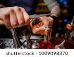 bartender in a blue shirt with... | Shutterstock . vector #1009098370