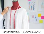 young woman dressmaker or... | Shutterstock . vector #1009116640