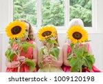 3 girls  3 sunflowers  by 3... | Shutterstock . vector #1009120198