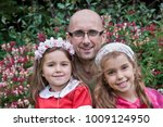 dad and his daughters by... | Shutterstock . vector #1009124950