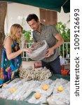 man selling herbage   Shutterstock . vector #1009126693