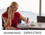 woman talking on the phone | Shutterstock . vector #1009127833