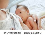 Close Up Mother Breast Feeding...