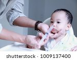 father making nasal wash for... | Shutterstock . vector #1009137400