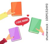 hands with books. i love books... | Shutterstock .eps vector #1009152493