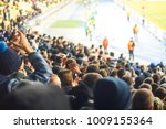 football fans clapping on the... | Shutterstock . vector #1009155364