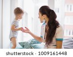 the young doctor sitting on a... | Shutterstock . vector #1009161448