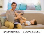 the smiling young father... | Shutterstock . vector #1009162153