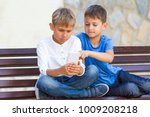 boys with mobile phone sitting... | Shutterstock . vector #1009208218