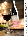 glass of red wine with french... | Shutterstock . vector #1009226698