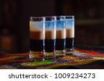 four classic shot cocktails on...   Shutterstock . vector #1009234273