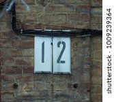 Small photo of House address number 12