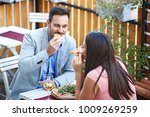 love couple enjoying pizza and... | Shutterstock . vector #1009269259