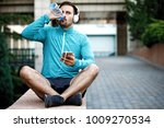 man is listening music and... | Shutterstock . vector #1009270534