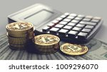 piles of bitcoin laying on... | Shutterstock . vector #1009296070