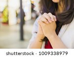 a young woman praying for god's ... | Shutterstock . vector #1009338979