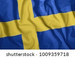 the swedish flag is flying in... | Shutterstock . vector #1009359718