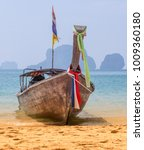 long tail boat on the beach in... | Shutterstock . vector #1009360180