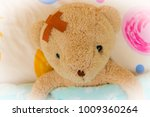 teddy bear in bed with sore... | Shutterstock . vector #1009360264