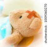 sick teddy bear in bed with... | Shutterstock . vector #1009360270
