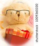 teddy bear just got a gift box | Shutterstock . vector #1009360330