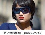 unhappy young diverse woman   Shutterstock . vector #1009369768