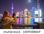 young tourist woman taking... | Shutterstock . vector #1009388869