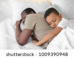 african american man sleeping...   Shutterstock . vector #1009390948