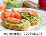 whole wheat bread with green... | Shutterstock . vector #1009421248