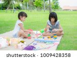 asian child happy play in park | Shutterstock . vector #1009428358