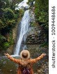 woman in hat rise her hand near ... | Shutterstock . vector #1009448686