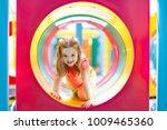 kids climbing and sliding on... | Shutterstock . vector #1009465360