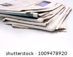 newspaper piled up on a table | Shutterstock . vector #1009478920