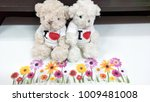 Small photo of The paper flower with white background Stuffed dog accompanying liver.