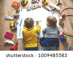 kids drawing on floor on paper. ... | Shutterstock . vector #1009485583